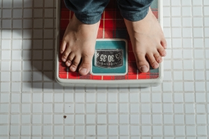 A person standing on weighing scales.